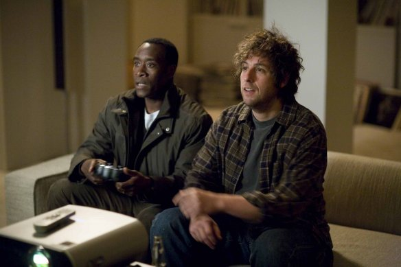 Don Cheadle (left) and Adam Sandler (right) star in Columbia Pictures' Reign Over Me.